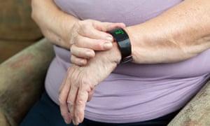 An elderly woman wearing a Fitbit