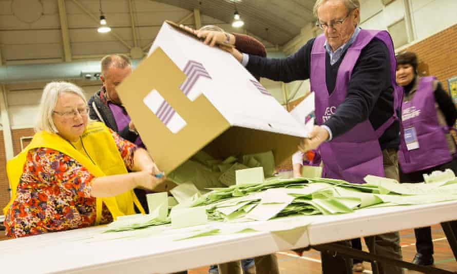 Electoral officials vote counting on 2 July.