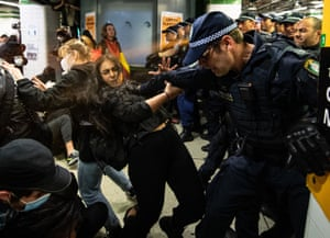 Police spraying protesters with pepper spray inside Central Station after the rally.