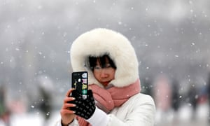 A woman takes a selfie in the snow