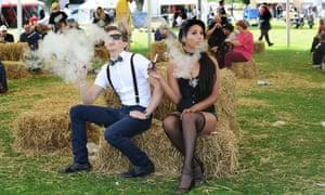 Nagy Memes Szabolcz and Georgia Samuels of Birmingham relax with an e-cigarette at Vapefest in Shrewsbury.