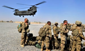 Troops wait to board an Australian air force Chinook helicopter in Afghanistan