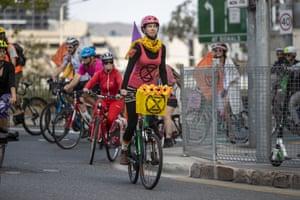 Brisbane, Australia Extinction Rebellion protesters on bicycles rally in Brisbane