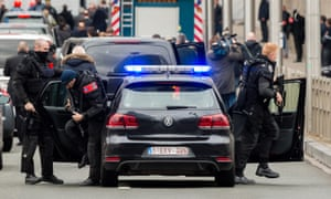 Special operations police get out of their car as they protect the French prime minister, Manuel Valls, prior to laying flowers at Maelbeek metro station in Brussels