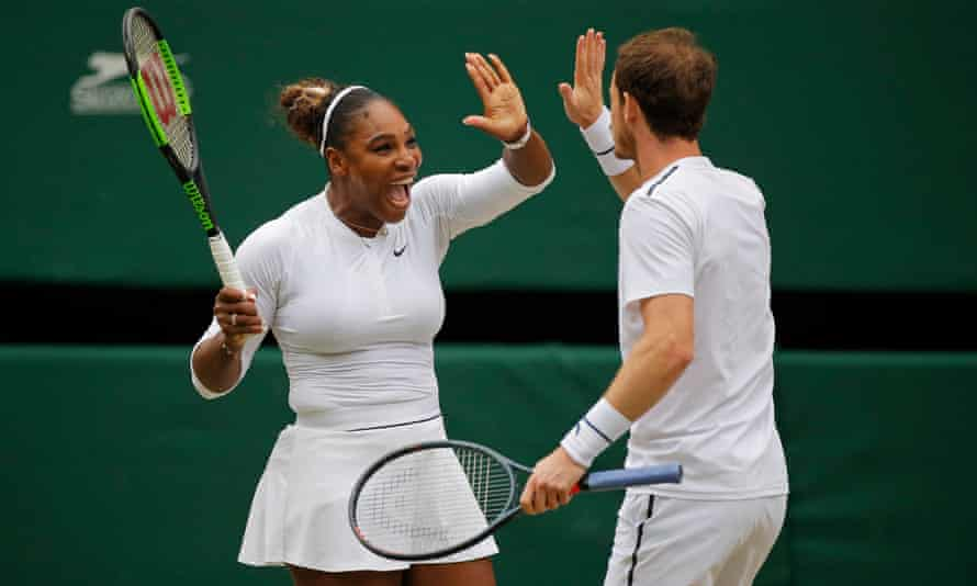 Serena Williams celebrates winning a point in her mixed doubles match with Andy Murray on Centre Court during day eight of the 2019 Wimbledon tennis championships at the All England Lawn Tennis Club on July 9th 2019 in Wimbledon