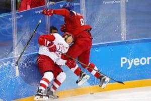 Jakub Nakladal (R) of Czech Republic in action against Sergei Andronov of OAR during the men's ice hockey semi-final, which OAR won 3-0