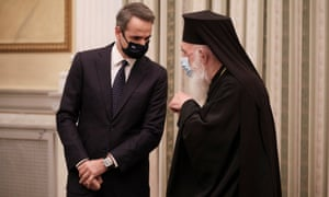 Greek PM Kyriakos Mitsotakis talks with Archbishop Ieronimos during a swearing-in ceremony of newly appointed members of the government at the presidential palace, in Athens today
