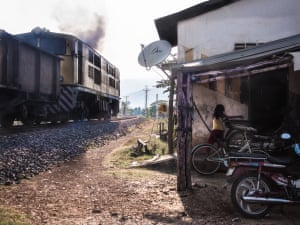 """<strong>A girl dashes into her house at the same time a train runs past</strong><br>I was waiting at a train crossing on the outskirts of Kampot town in Cambodia. I noticed a girl waiting outside her house before the train came, but after I took the shot and reviewed the image, I saw that she was in the process of running inside as it passed by. The combination of the anticipated motion of the train and the unexpected movement of the girl struck me as a fascinating kinetic contrast<br>Photograph: <a href=""""https://witness.theguardian.com/assignment/55b0f634e4b02ab2dca28ece/1639269"""">Simon Slater/GuardianWitness</a>"""