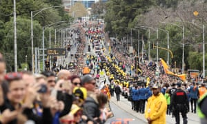 Fans lining the parade route during the 2019 AFL grand final parade on 27 September 27 2019 in Melbourne, Australia.
