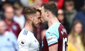 Ashley Barnes of Burnley kisses Joe Bennett of Cardiff City as they clash.