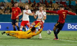 Spain's Alvaro Morata's shot is blocked by Poland's keeper Wojciech Szczesny.