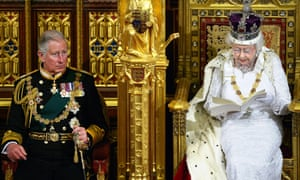 The Queen sits with Prince Charles as she delivers her speech