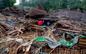 Sittwe, Burma Residents search for belongings from one of the destroyed buildings hit by a tornado