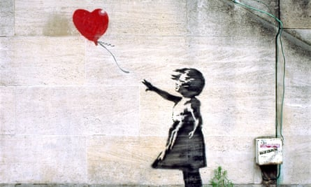 Banksy girl with red balloon on a South Bank wall near the National Theatre, London England UK
