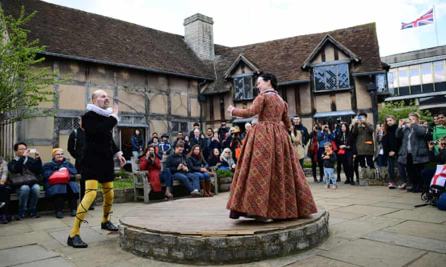 People watch a performance in the grounds of Shakespeare's birthplace