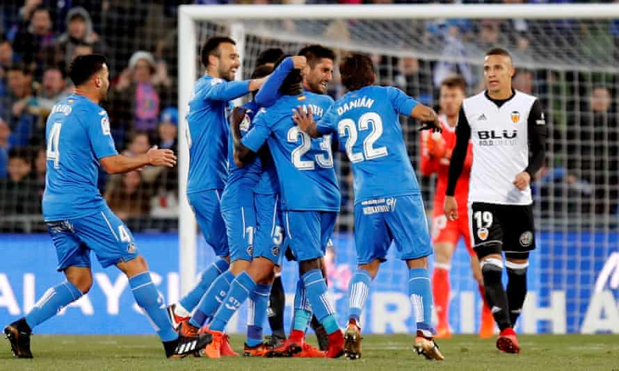 Getafe players celebrate after scoring the opening goal against Valencia.