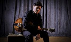Robbie Robertson Press publicity portrait with guitar
