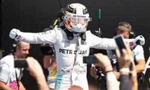 Lewis Hamilton celebrates after winning.