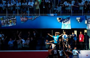 Diego Maradona is pictured soaking up the sunlight – and the crowd's adulation – prior to the vital Group D game against Nigeria.