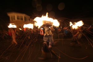 Allendale, Northumberland: People parade through the streets carrying barrels of burning tar