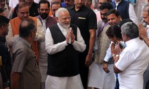 Prime Minister Narendra Modi greets wellwishers in New Delhi.