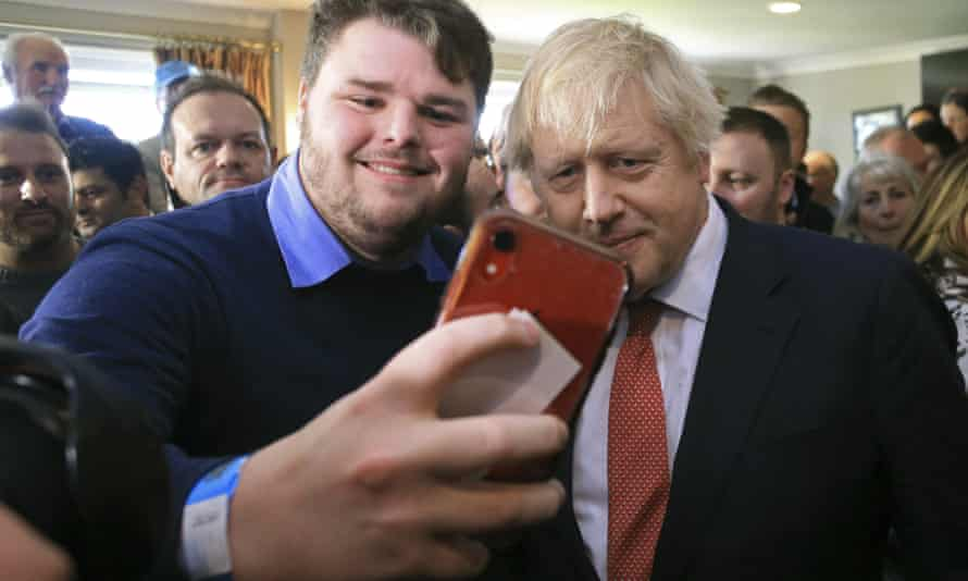 Johnson with supporters during a visit to Sedgefield in County Durham on Saturday.
