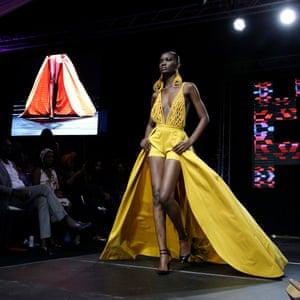 Model Nafissatou Gningue walks the runway at Dakar fashion week, July 2017