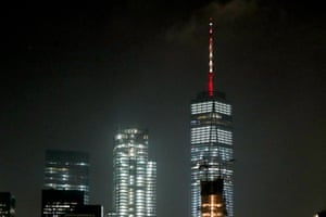One World Trade Center spire lit with the colours of the Spanish flag.