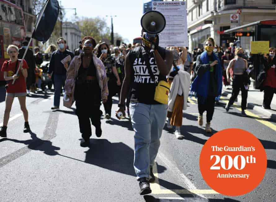 Protesters march during joint 'Kill the Bill' and 'Black Lives Matter' protest in London, Sunday, April 25, 2021. The demonstration is against the contentious Police, Crime, Sentencing and Courts Bill, which is currently going through Parliament and would give police stronger powers to restrict protests. (AP Photo/Alberto Pezzali)