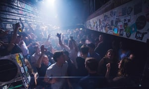 A packed dancefloor under strobing lights at Club NYX in Amsterdam.