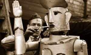 Mr Charles Lawson, an electrical engineer from Kettering lights his robot's cigarette.