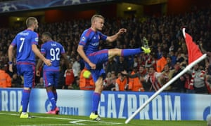 Olympiakos's striker Alfred Finnbogason celebrates in unusual fashion after scoring what turned out to be the winner, less than a minute after Arsenal had equalised.