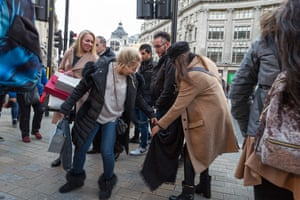 Women admire a pashmina. Some stores slashed prices by 70% over the Christmas period as the surge in online shopping to pile pressure on the high street