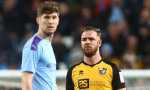 Port Vale's Tom Pope (right) later joked he would score 50 goals a season if he played against John Stones every week.