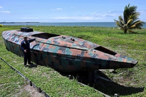 Dager displays a camouflaged homemade narco-submarine
