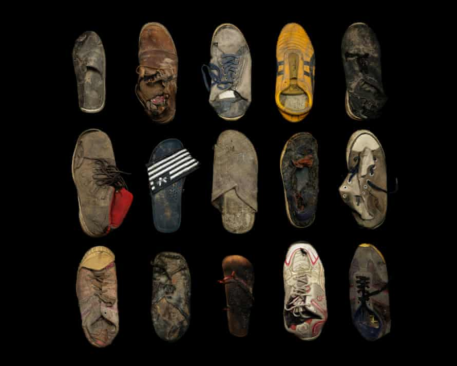 Gideon Mendel lined up footwear abandoned or lost by child refugees.