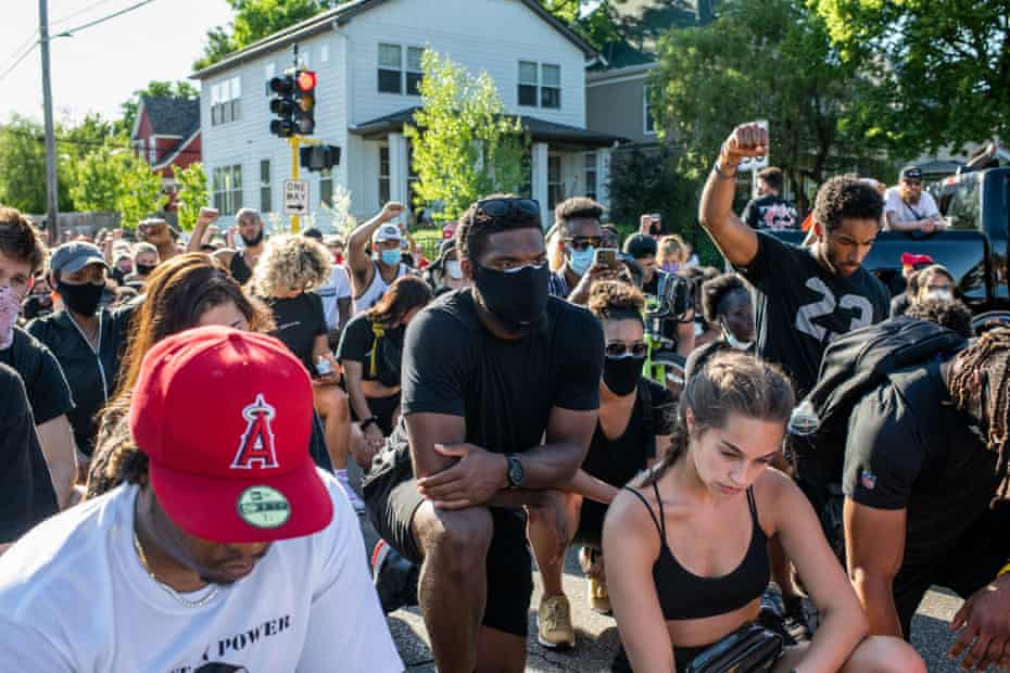 Demonstrators protest the death of George Floyd on June 5, 2020 in Minneapolis, Minnesota. Floyd died while in police custody on May 25, after former Minneapolis police officer Derek Chauvin kneeled on his neck for nearly nine minutes while detaining him. His death has sparked nationwide protests and rioting.