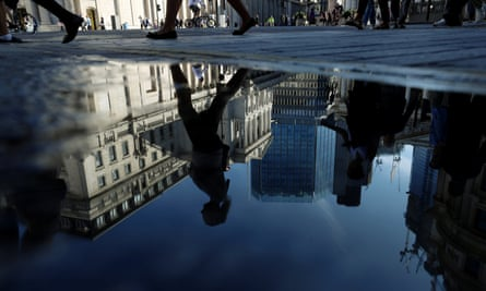 Bank of England reflected in puddle