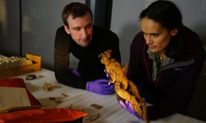 Mary-Ann Ochota and Nicholas Crowe examining a mandrake root in Mystic Britain.