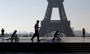 People exercise at Trocadero square in Paris under lockdown