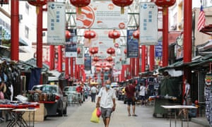 Shoppers wearing protective masks shop at China Town ahead of the Lunar New Year, following the coronavirus disease (COVID-19) outbreak, in Kuala Lumpur, Malaysia February 10, 2021.