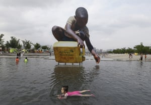 A girl swims to cool down in Seoul, South Korea