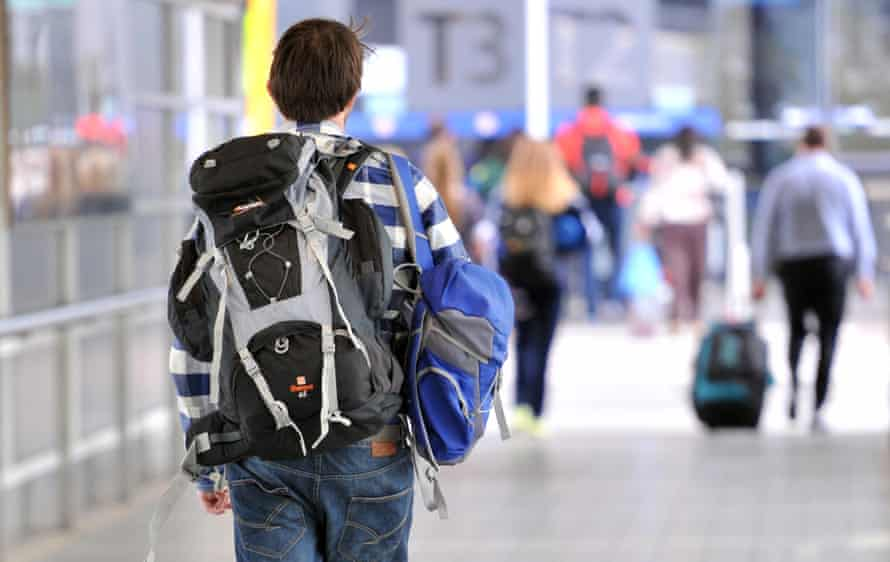 A backpacker makes his way to the international terminal at Melbourne airport.