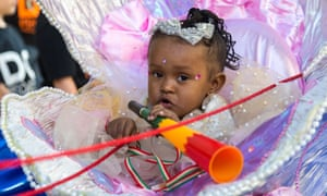 A little girl's stroller is decked out like a clam shell as Notting Hill Carnival gets under way, 2017.