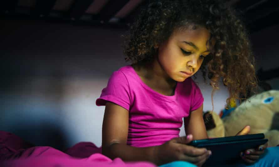 Young girl looking using a digital device