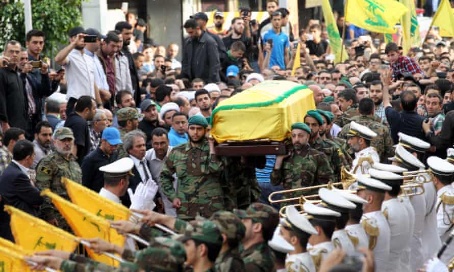 Hezbollah fighters carry the coffin of Mustafa Badreddine, a top commander killed fighting in Syria, during his funeral in Beirut in May 2016.