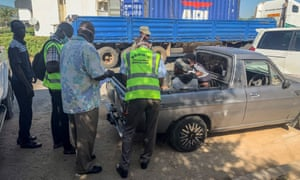 Police talk to some of the survivors found in the cargo container