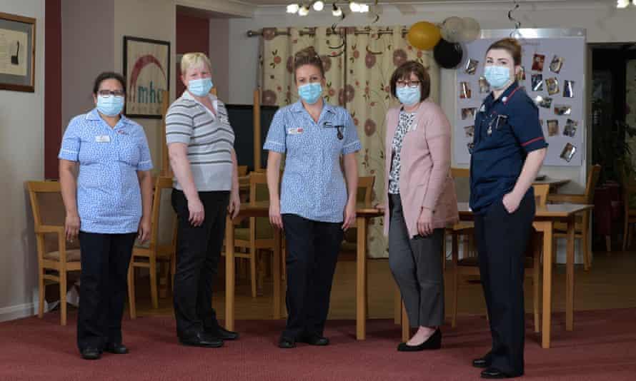 Julie Roche with staff
