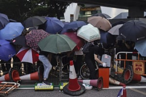 Protesters huddle together to block a road in Hong Kong