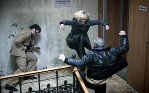 Charlize Theron fighting on the staircase in Atomic Blonde